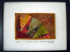 Framed Postcard Quilt from Kalahari Quilts, Botswana. Donated by Cindy Friedman, Fiber Artist